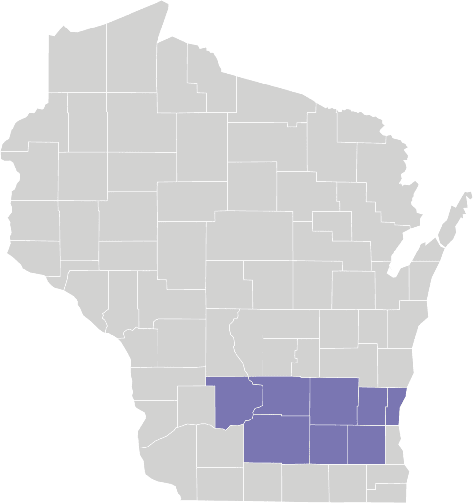 A gray map of Wisconsin with 8 purple counties colored in to show Partnership program coverage