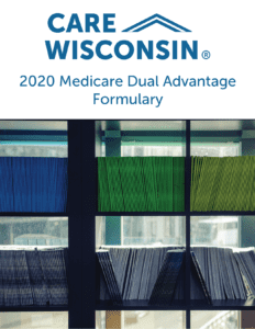 "library shelves containing booklets + ""2020 Medicare Dual Advantage Formulary"""