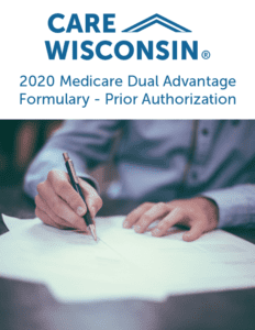 """Man signs documents +""""2020 Medicare Dual Advantage Formulary - Prior Authorization"""""""